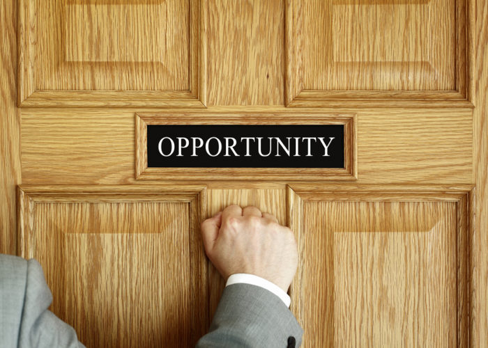 "Businessman knocking on a door to ""Opportunity"" office concept f"